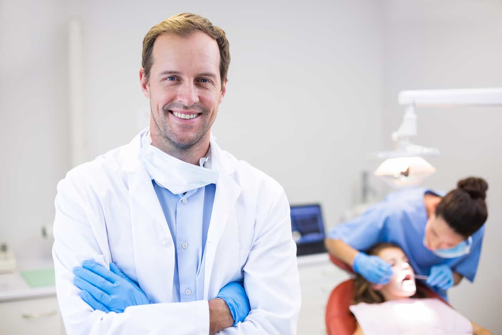 Ashford Dental Centre bigstock-Portrait-of-dentist-standing-w-187221421 Why Choose Ashford for your Wisdom tooth removal? Uncategorized  Oral Hygiene General Wellness Dental Health